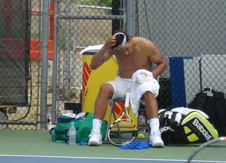 Rafael Nadal shirt change Cincinnati Western and Southern Open Sunday practice shirtless hands headband hair pecs towel