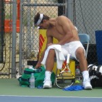 Rafael Nadal shirt change Cincinnati Western and Southern Open Sunday practice tousled hair shirtless naked abs biceps back legs