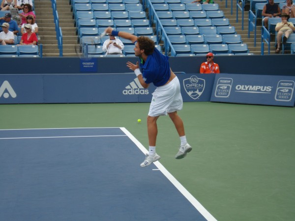 Western & Southern Open Ernests Gulbis Qualifier serve naked back white shorts leap pictures photos