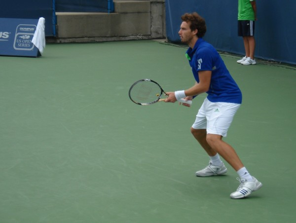 Western and Southern Open 2011 Ernests Gulbis return of serve white blue tennis photos pictures images
