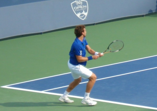 Qualifier Ernests Gulbis Western and Southern Open tennis racquet blue white calf muscles backhand court pictures photos images