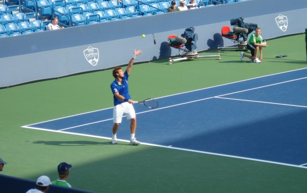 Ernests Gulbis ball toss qualifier Western and Southern Open muscles tendons pretty pictures images photos blue white