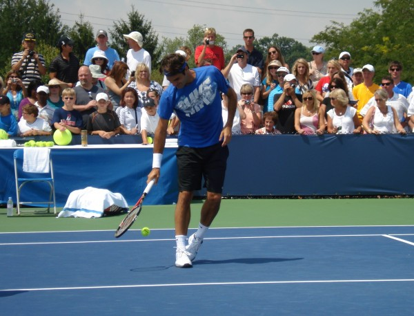 Fed smiling playing around Cincinnati Open practice Monday blue racquet tennis ball pictures photos images